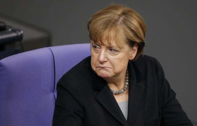 默克尔开放的移民政策在最近的袭击中接受挑战
