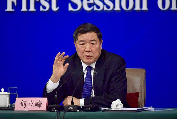 发改委主任何立峰表示2018年GDP增长6.5%目标可实现.jpg